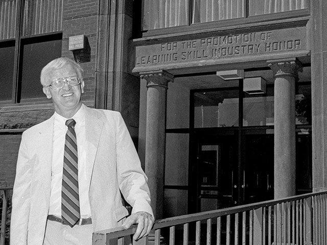 Charles W. Sorensen poses at the entrance to Bowman Hall