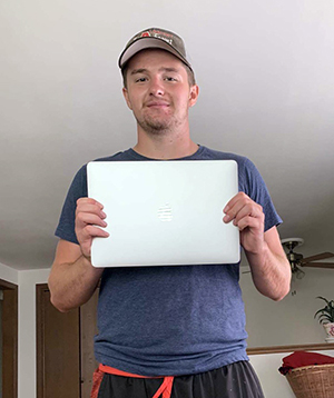 UW-Stout first-year student Noah Chaltry with his laptop computer.