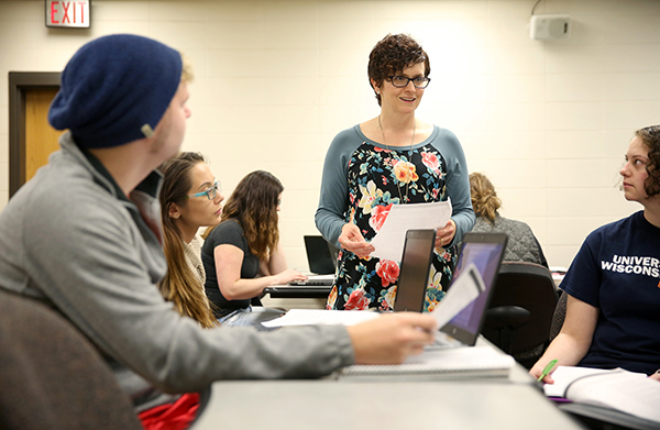 Amanda Barnett works with students in a Family Policy class at UW-Stout.