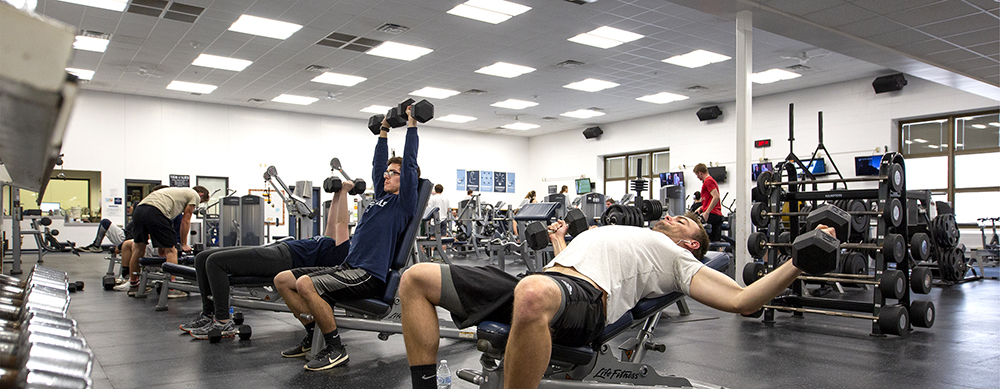 Students exercise in the fitness room