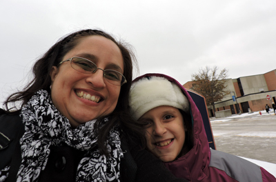 With her daughter, Anisa, 9, Veronica Solano visits campus in December for commencement. It was the first time Anisa experienced snow.