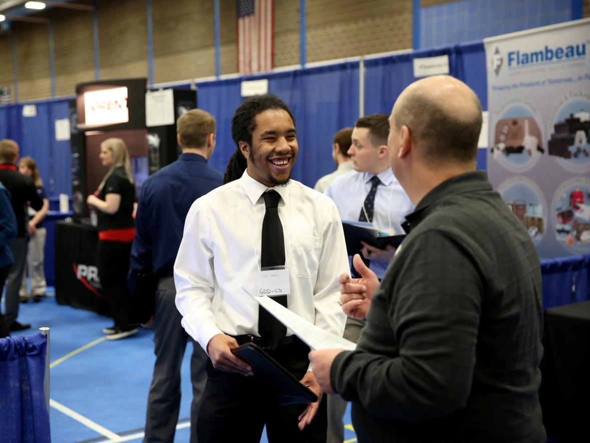 Jalen Hendley, a computer science-game design major from Flossmoor, Ill., visits with a recruiter at a 2017 Career Conference.