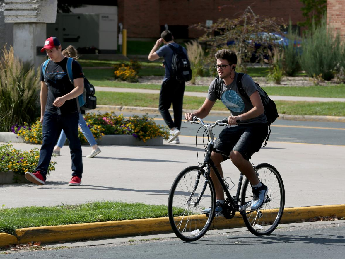 A student bikes through campus recently.