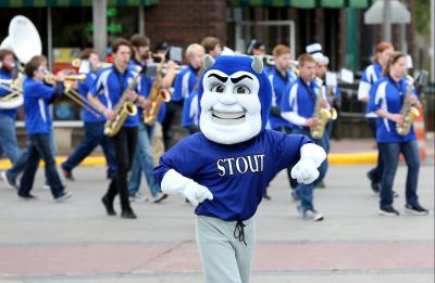Blaze, the UW-Stout mascot, dances to Blue Devil Jazz Project band during the Homecoming Parade.