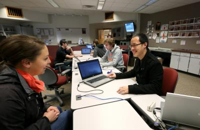 Staff helping a student at the Technology Help Desk in Millennium Hall.
